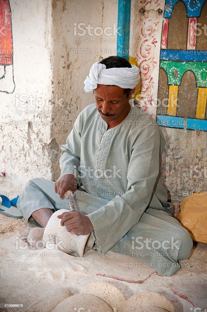 Egyptian man at an alabaster factory stock photo