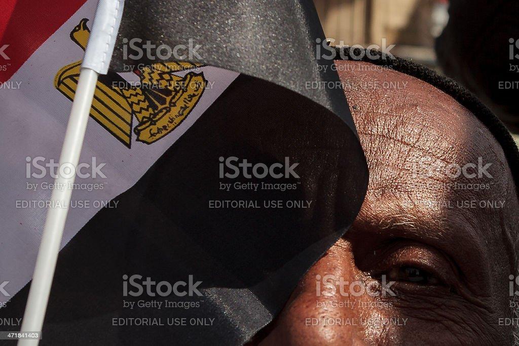 Egyptian man behind flag on Tahrir royalty-free stock photo