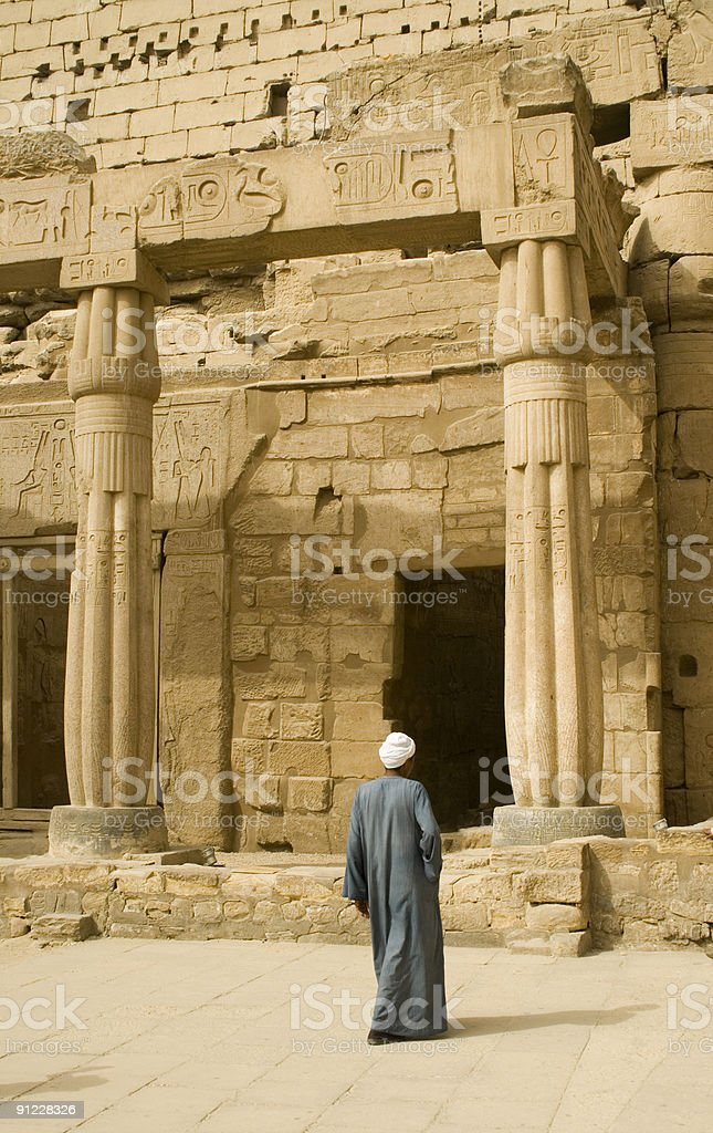 Egyptian man in front of Luxor Temple Egypt stock photo