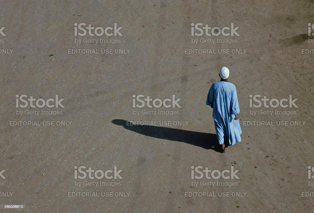 Egyptian man walking in Luxor, Cairo stock photo