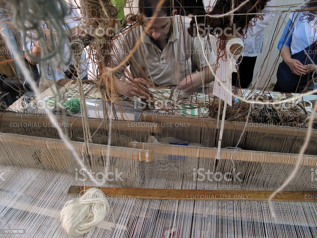 Egyptian Man Weaving a Magic Carpet royalty-free stock photo