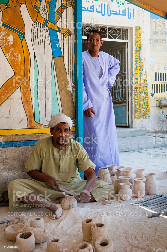 Egyptian men at an alabaster factory stock photo