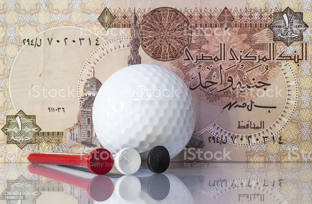 Egyptian money and golf equipments royalty-free stock photo