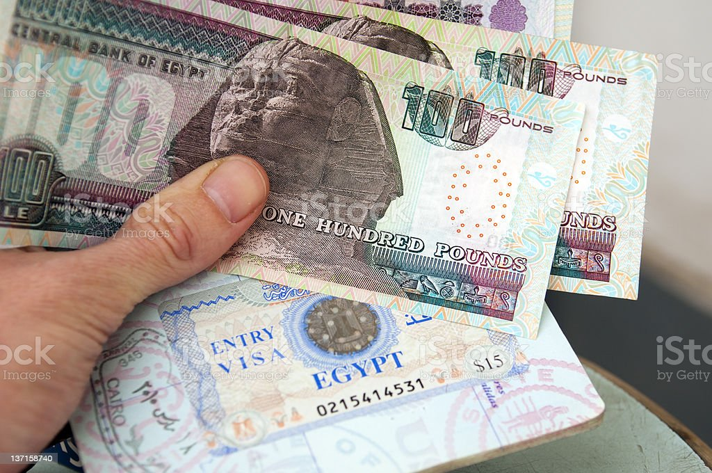 Egyptian money and visa stock photo