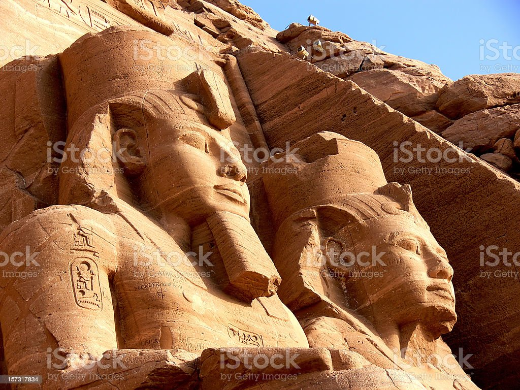 Egyptian pyramid statues in the sunset stock photo