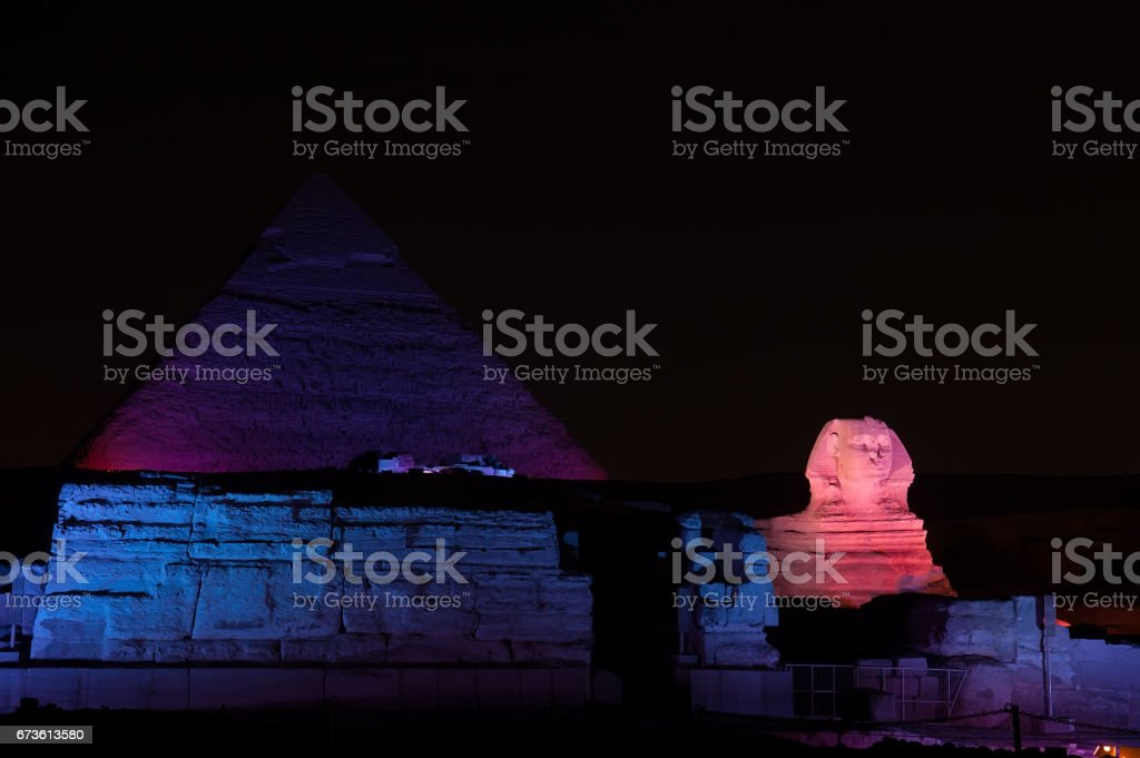 Egyptian pyramids at night with lights stock photo
