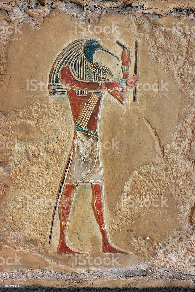 Egyptian relief of Thoth stock photo