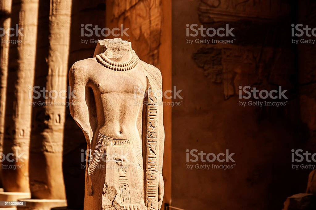 Egyptian Statue with hieroglyphic carvings stock photo
