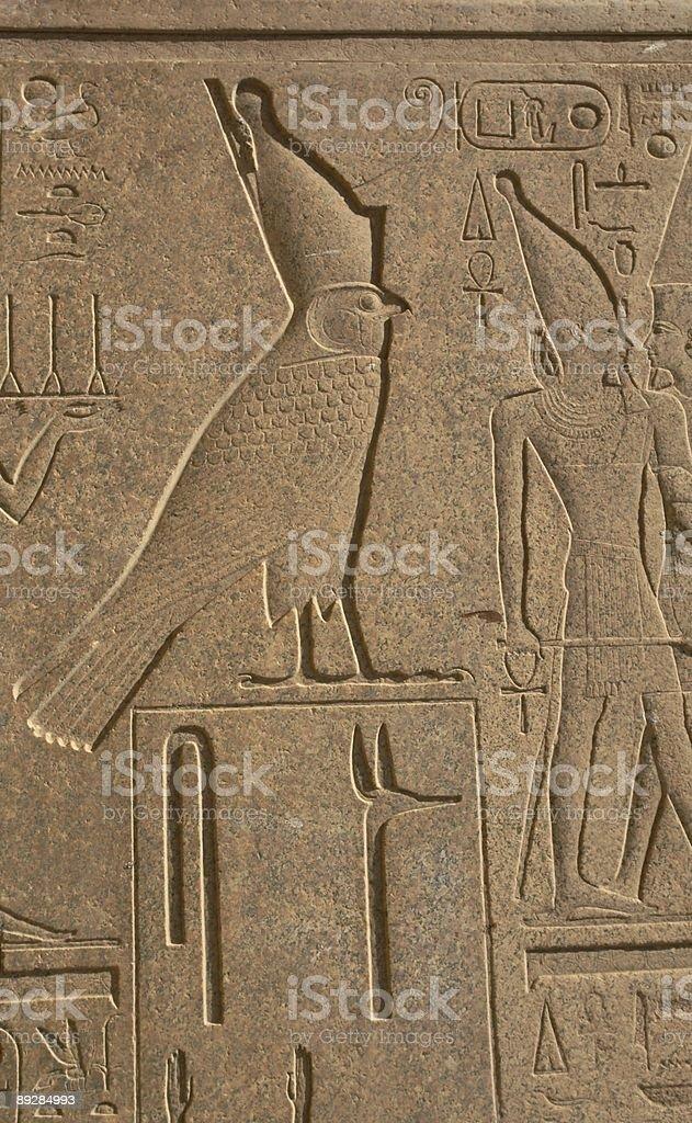 Egyptian symbols: god Horus in falcon form royalty-free stock photo