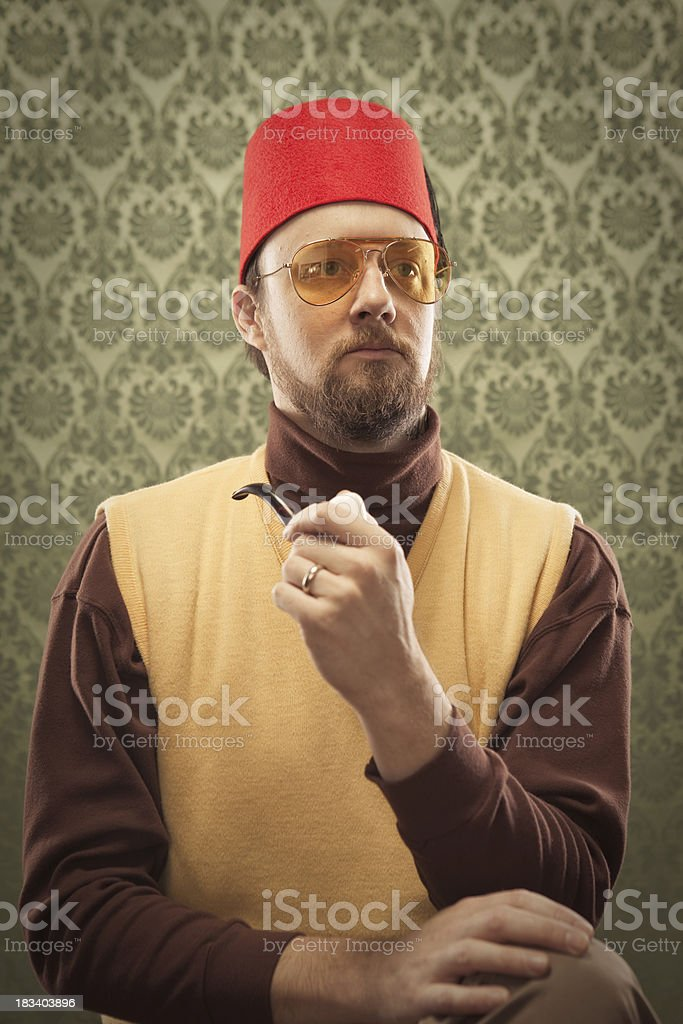 Egyptian wise Man vintage holding pipe in mouth & fez stock photo
