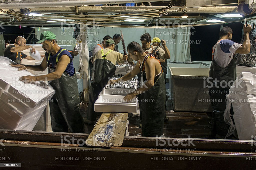 Egyptian workers in Greek fishing boats royalty-free stock photo