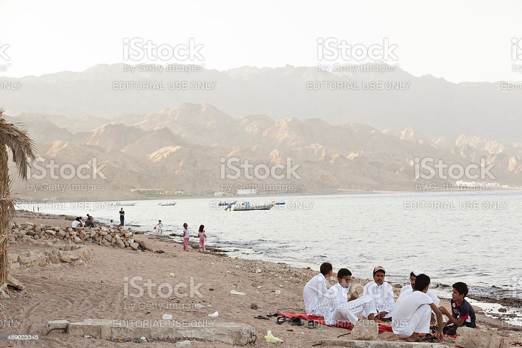 Egyptian young men rest on the beach. stock photo