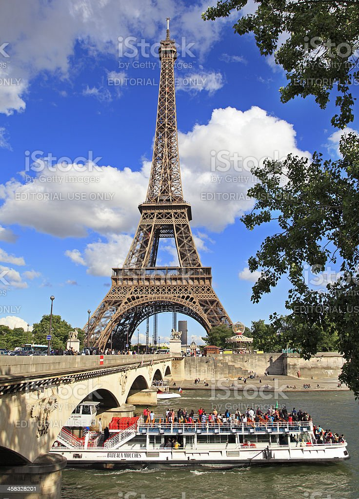 Eiffel Tower and Bateau Mouche in Paris royalty-free stock photo