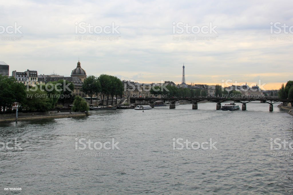 Eiffel tower and bridge over the Seine river, during sunset, France stock photo