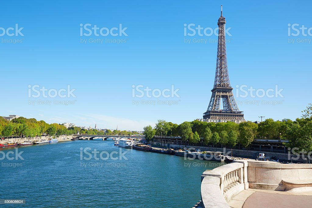 Eiffel tower and empty white balustrade in sunny day in Paris stock photo