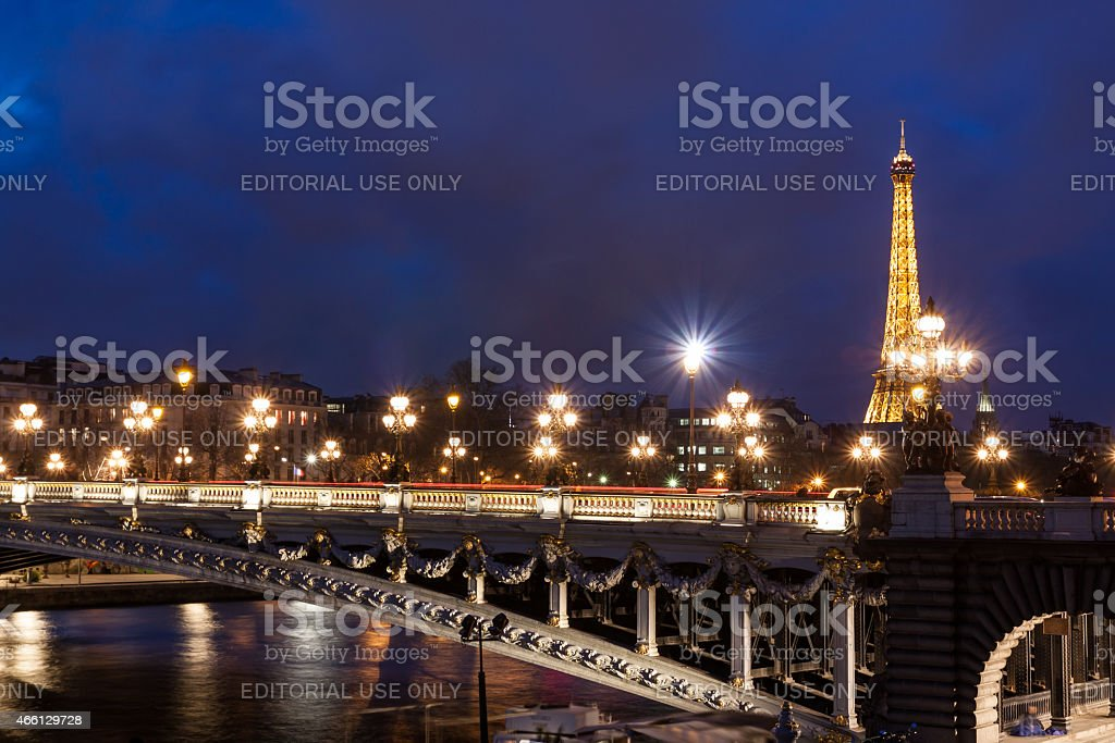 PARIS: Eiffel Tower and Pont Alexandre III at night stock photo