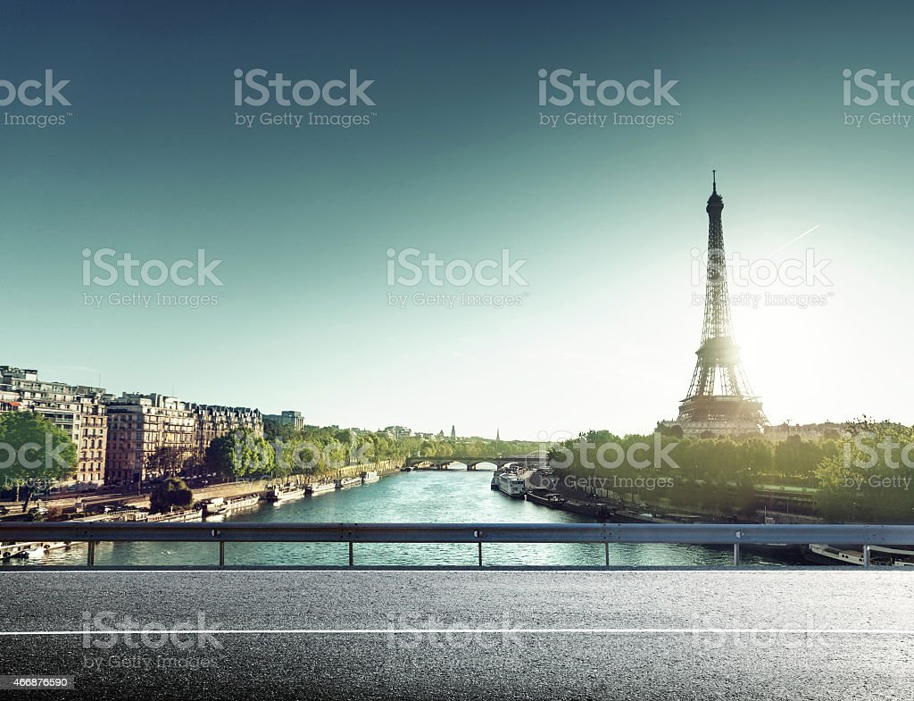 Eiffel Tower and road in sunrise time stock photo