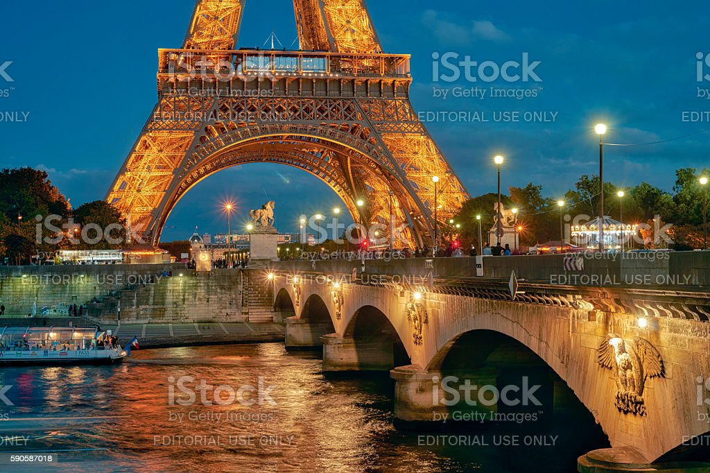 Eiffel Tower and Seine river at night stock photo
