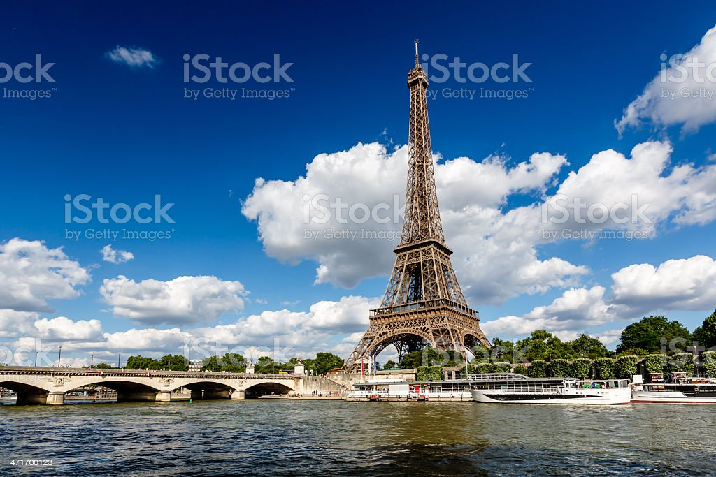 Eiffel Tower and Seine River with White Clouds in Background royalty-free stock photo