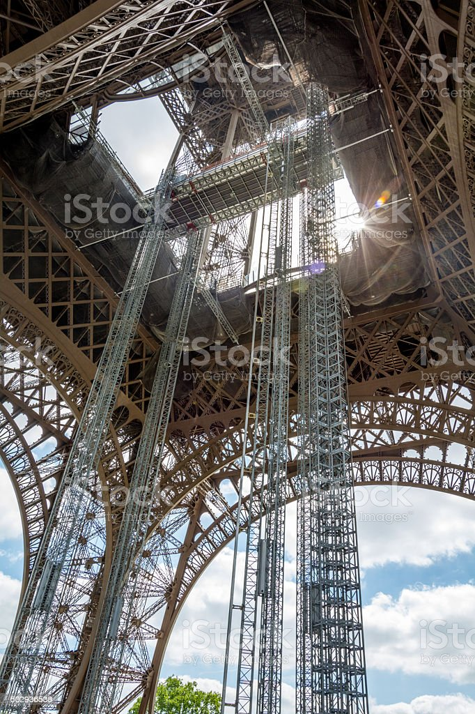 Eiffel tower from the bottom with flare stock photo