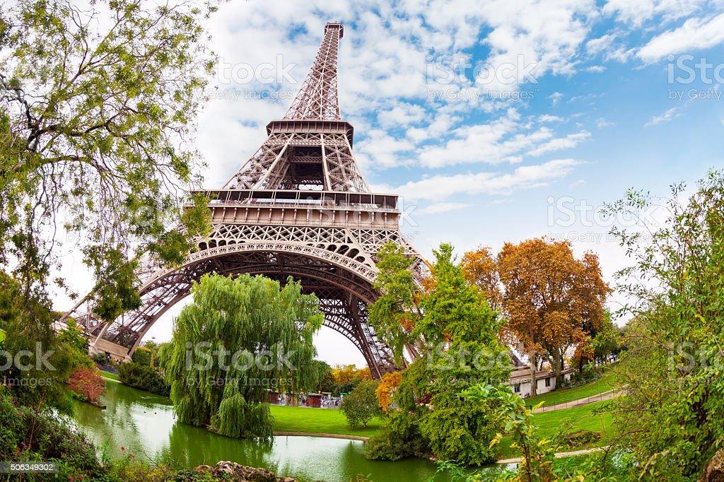 Eiffel Tower in Paris France and pond near stock photo