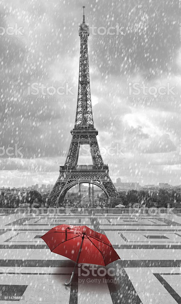 Eiffel tower in rain. Black white photo with red element stock photo