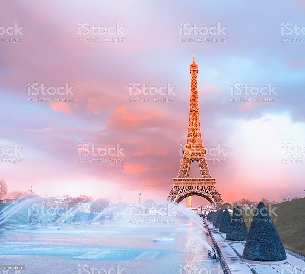 Eiffel tower lit  with last rays of Sun stock photo