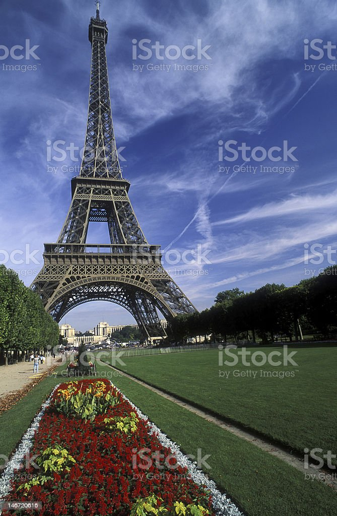 Eiffel Tower, Paris, France with Flower Bed against Blue Sky stock photo