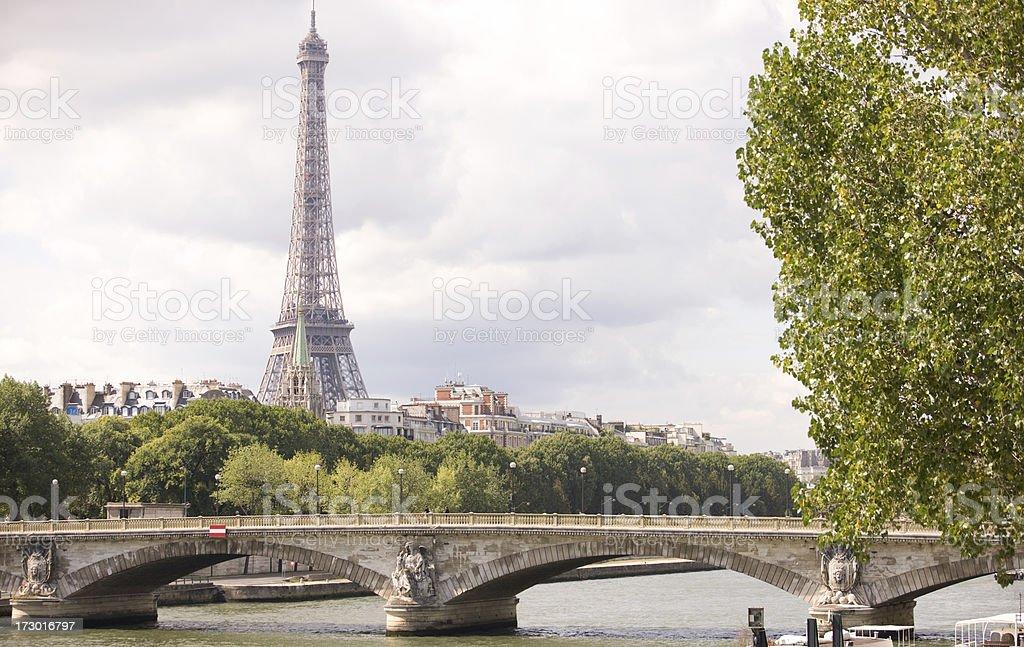 Eiffel Tower past a bridge royalty-free stock photo