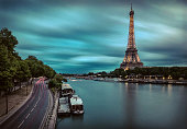 Eiffel Tower under motions clouds. Night view Paris