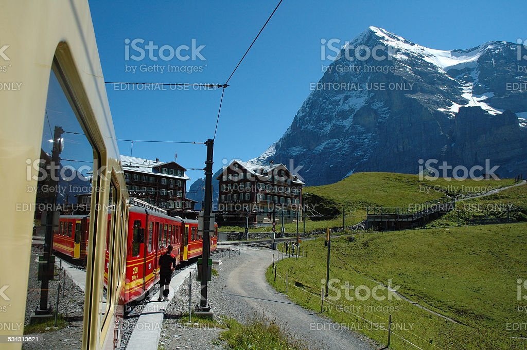 Eiger mountain and train in Kleine Scheidegg in Switzerland stock photo