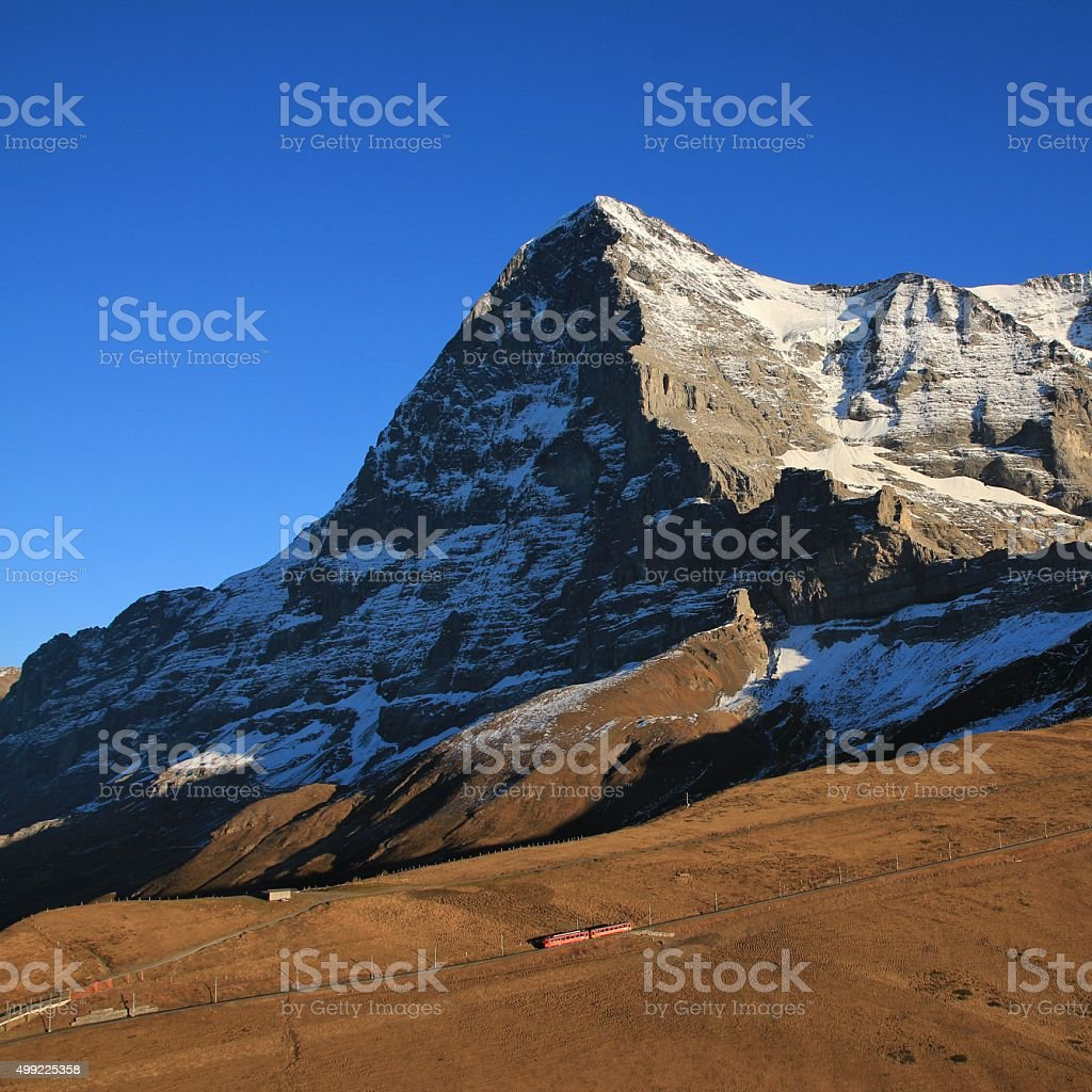 Eiger North Face and train stock photo