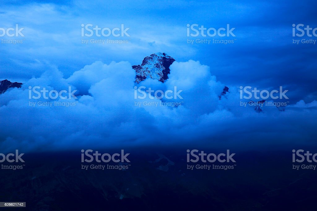 Eiger pinnacle, dramatic storm clouds evening, Bernese Oberland, Swiss Alps stock photo