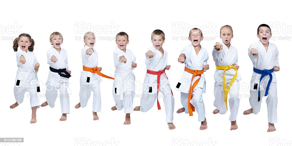 Eight athletes in karategi hit punch arm stock photo