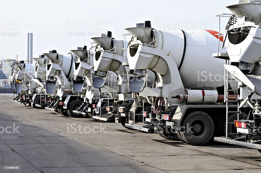 eight clean cement trucks in a row stock photo