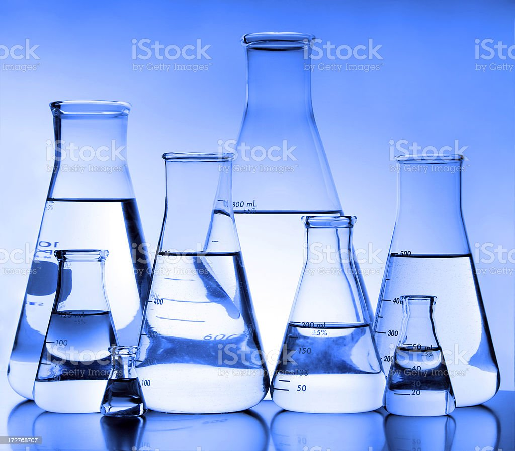 Eight Erlenmeyer Flasks Blue Tint royalty-free stock photo