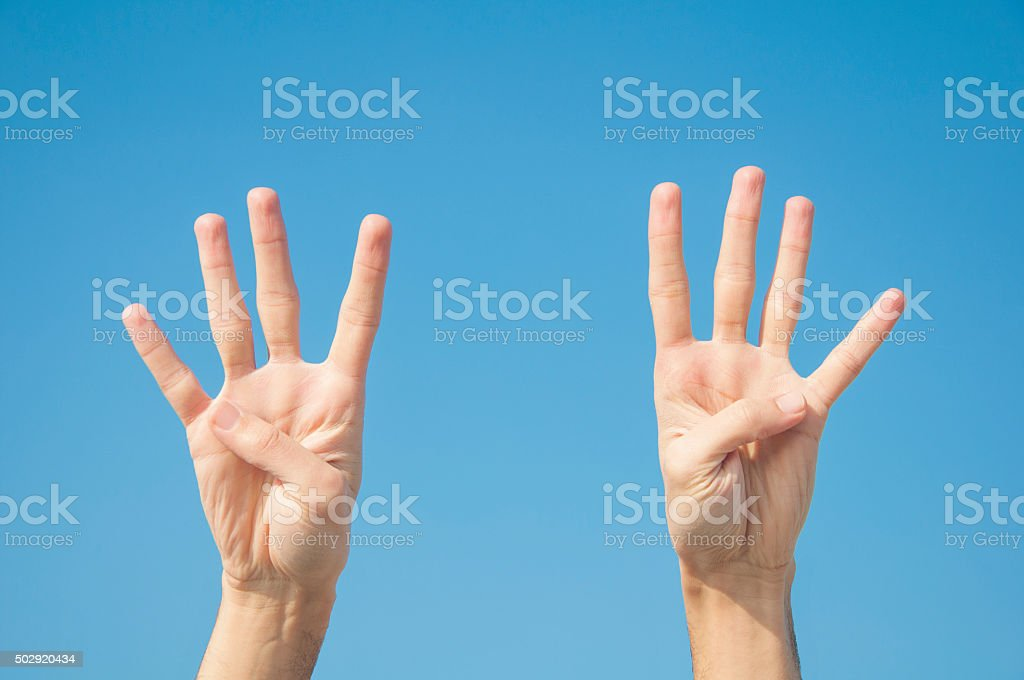 Eight fingers with two hands. stock photo