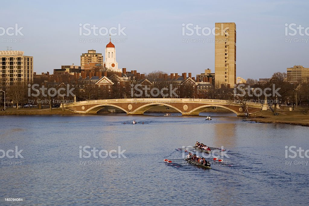 Eight man sculls on the Charles River, late afternoon. stock photo