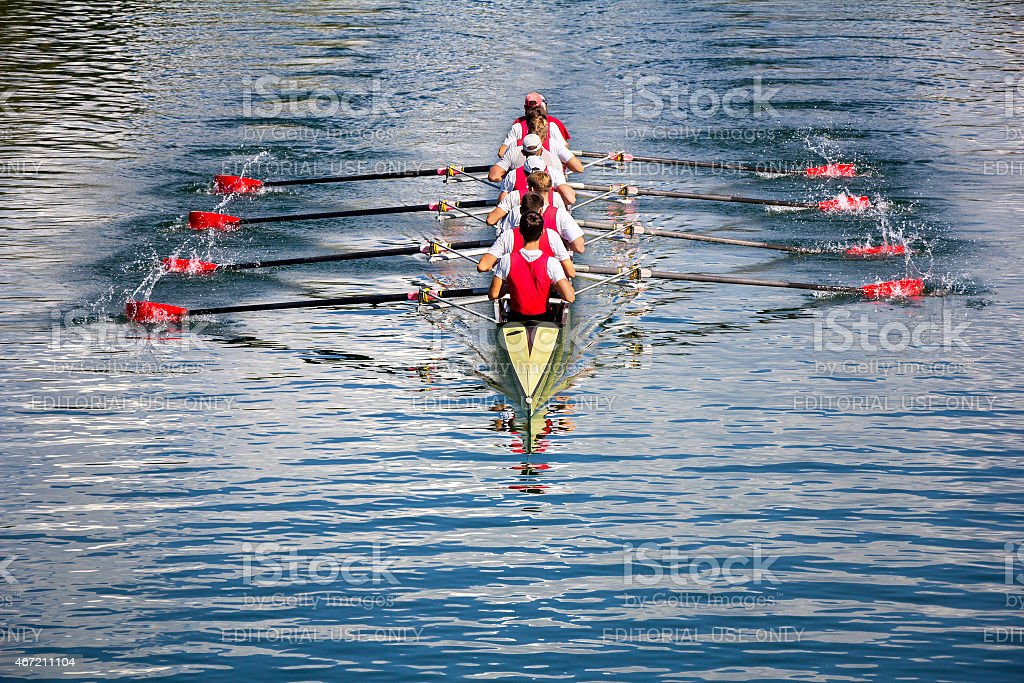Eight men rowing stock photo