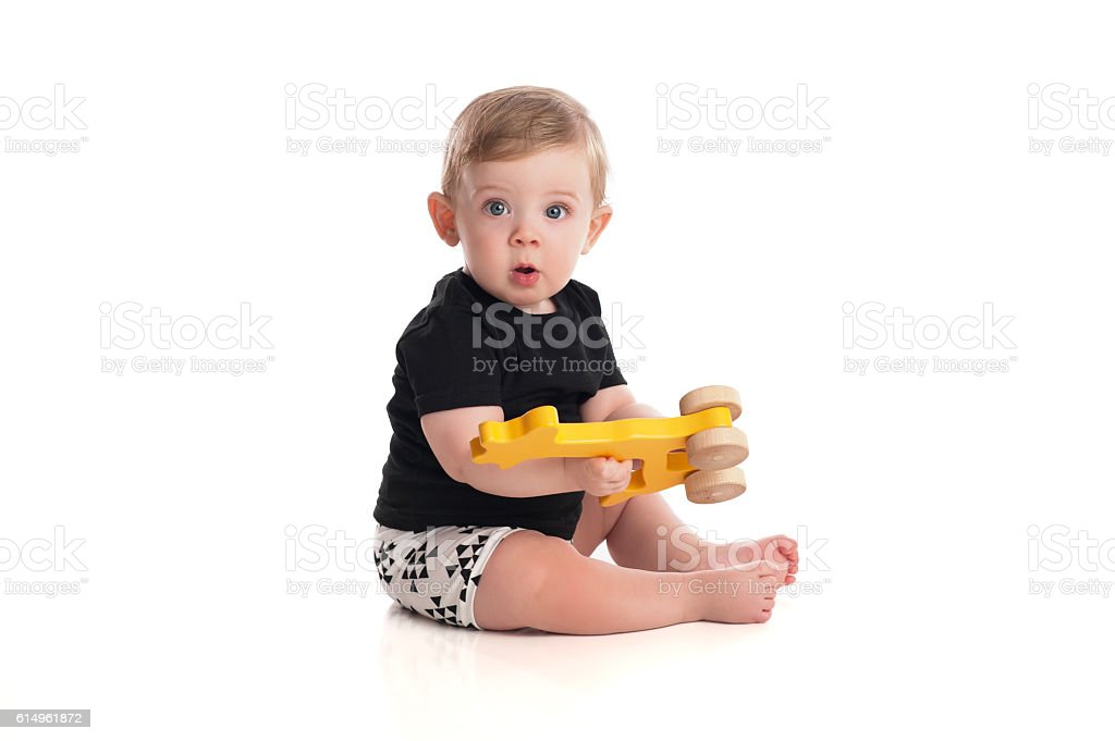 Eight Month Old Baby Boy Playing with Toy stock photo