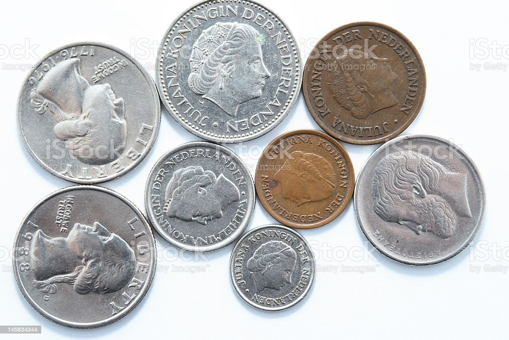 Eight old coins from different contries on white background stock photo