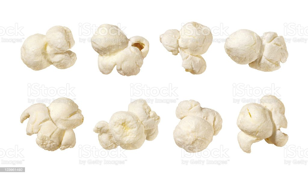 Eight pieces of popcorn isolated on white background stock photo