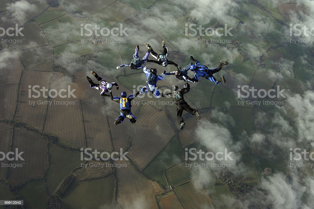 Eight Skydivers building a formation royalty-free stock photo