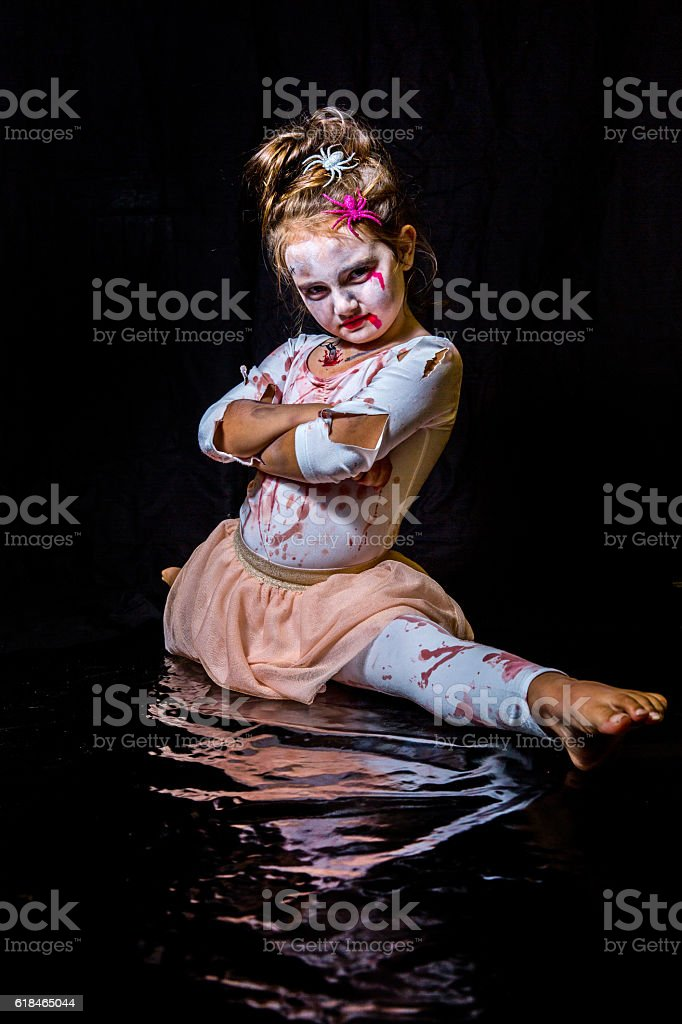 Eight year old girl in halloween outfit stock photo
