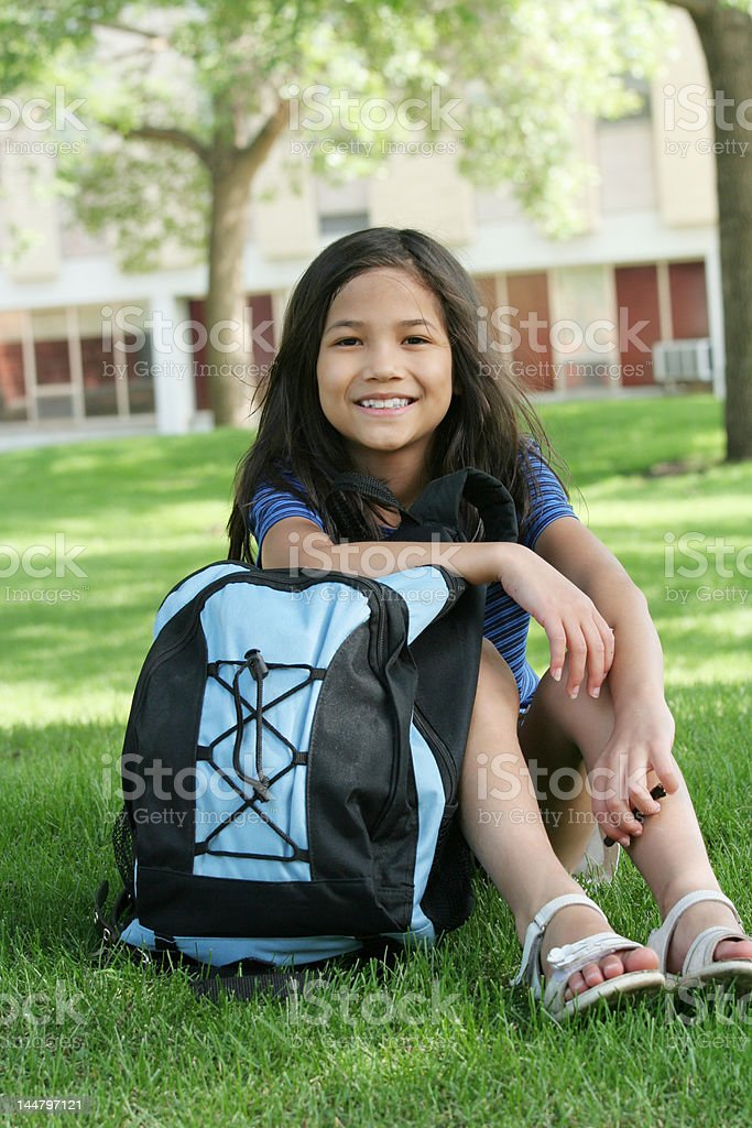 Eight years old girl with backpack ready for school stock photo