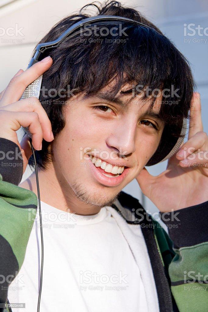 eighteen year old listening to headphones royalty-free stock photo