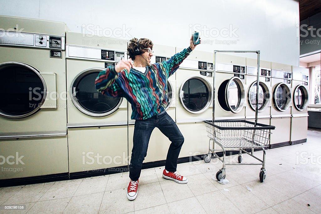 Eighties Man Dancing at Laundromat stock photo