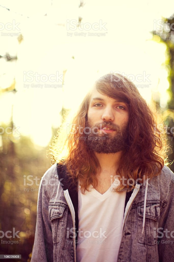Eighties Smiling Young Man Portrait with Beard royalty-free stock photo