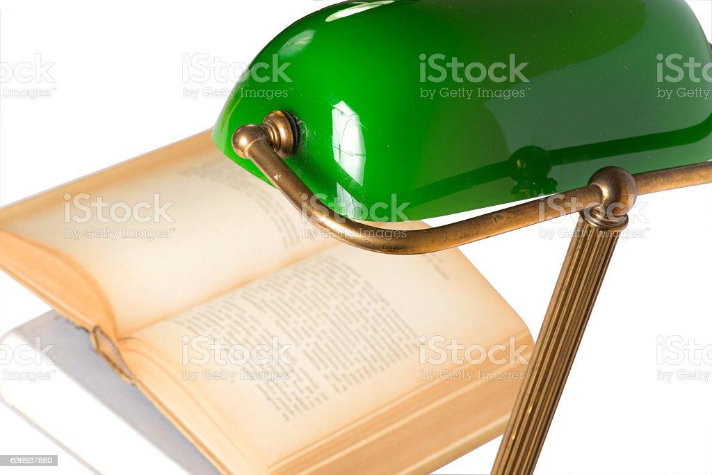 Eine Leselampe und ein Buch stock photo