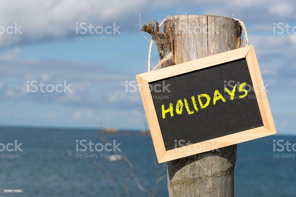 Eine Tafel mit dem Wort Urlaub stock photo